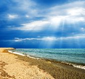 Sun above a sea Stock Photos