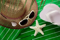 Sun accessories on beach towel Stock Images