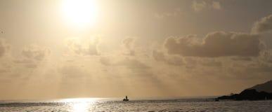 Sun acima da pesca Imagem de Stock