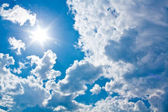 Sun against clouds. Sun is coming out of the clouds Stock Photography
