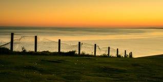 Sun ajustou-se em sete irmãs & x28; 2& x29; , Sussex, Inglaterra Imagens de Stock