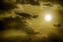 Sun amidst dark clouds Royalty Free Stock Photography