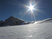 Sun And Snow Mountain Stock Images