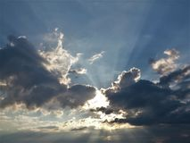 the sun appears between clouds Royalty Free Stock Photos
