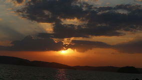 sun appears from clouds at fantastic sunset stock video footage