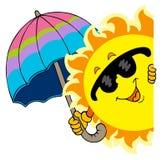 Sun appostantesi con l'ombrello Fotografia Stock