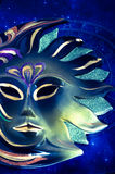 Sun astrology. A beautiful esoteric mask of sun over a blue astrological horoscope Royalty Free Stock Image