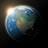Sun au-dessus de l'Amérique du Nord sur terre de planète Photographie stock libre de droits