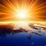 Sun au-dessus de la terre Photographie stock libre de droits