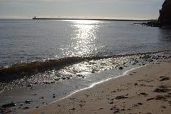 Sun auf dem Meer an tynemouth Hafen Stockfotografie