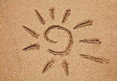 Sun auf dem Sand Stockbild
