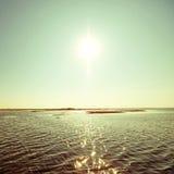 Sun auf See Stockbild