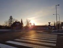 Sun augmentant dans la ville Photographie stock