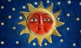 Sun avec le visage Photo stock