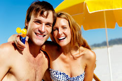 Sun awareness. Suncare couple on a summer beach vacation have good skincare with high spf sunblock Stock Images