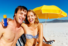Sun awareness. Suncare couple on a summer beach vacation have good skincare with high spf sunblock Stock Photo