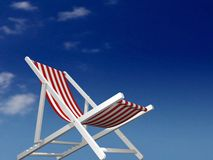 Sun-bath. Beach chair on the sunny day (view from the floor Royalty Free Stock Images