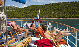 Sun bath and relax on cruise ship Stock Photos