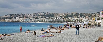 Sun bathers on the french shore stock image