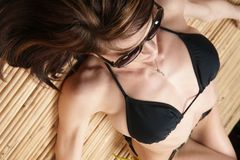 Sun Bathing Woman Black Bikini Tanning Herself Royalty Free Stock Photography