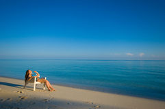 Sun bathing. A woman sun bathing on the beach royalty free stock photos