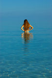 Sun bathing. A woman sun bathing on the beach Royalty Free Stock Photo