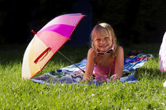 Sun bathing Stock Images
