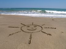 Sun on the beach. Summer concept:drawing of a sun on the beach Stock Image