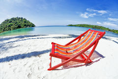 Sun beach chair at the beach Stock Photos