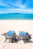 Sun beach chairs at the beach Stock Photography