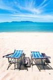 Sun beach chairs at the beach Stock Photography