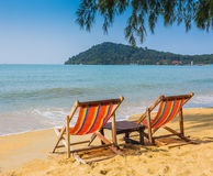 Sun beach chairs on shore near sea. Thailand royalty free stock images