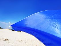 Sun Beach Umbrella Parasol on Sunny Day on Background of a Blue Sky Giving Shade and Protection.  stock image