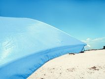 Sun Beach Umbrella Parasol on Sunny Day on Background of a Blue Sky Giving Shade and Protection.  royalty free stock images