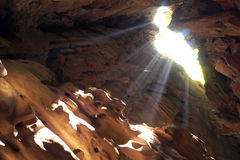Sun beam in cave Stock Images