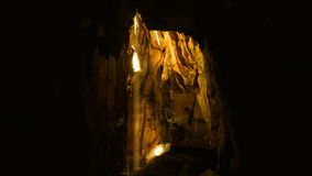 Sun beam in dark cave. stock video footage
