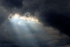 Sun Beam in Dark Clouds and Sky. Before Thunderstorm Stock Photos