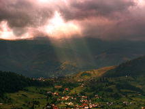 Sun beam over the village Stock Photography