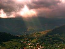Sun beam over the village Stock Photography