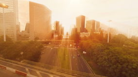 Sun beaming light over cityscape stock video footage