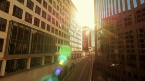 Sun beaming trough office buildings. modern glass architecture stock video