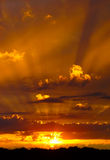 Sun beams. Gorgeous sunset with golden rays shining through the clouds stock image