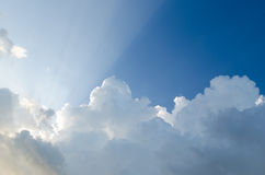 Sun beams through clouds with  blue sky Stock Images