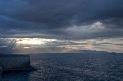 Sun beams, clouds, Mediterranean sea, Heraklion, Greece Stock Image