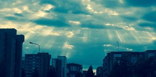 Sun beams through clouds Stock Images