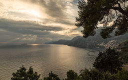 Sun beams over islands near Positano on the Amalfi coast in Ital Stock Photos