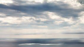 Sun beams over sea time lapse stock footage