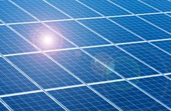 Solar panels for renewable energy with sun beams. Sun beams on solar panels as symbol for renewable energy royalty free stock photos