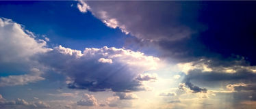 Sun beams thought clouds background 2 Stock Photography
