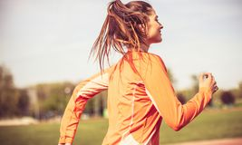 The sun and the beautiful day are more sans for jogging. stock photos